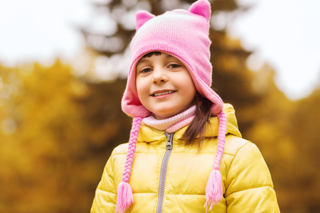 beautiful preteen girl: autumn, childhood, happiness and people concept - happy beautiful little girl portrait outdoors