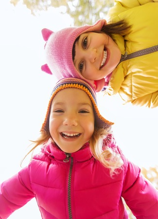 life style: childhood, leisure, friendship and people concept - happy girls faces outdoors Stock Photo