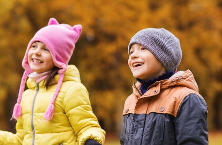 childhood: childhood, leisure, friendship and people concept - group of happy kids in autumn park