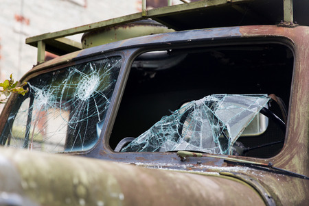 wartime: wartime, damage and danger concept - war truck with broken windshield glass outdoors