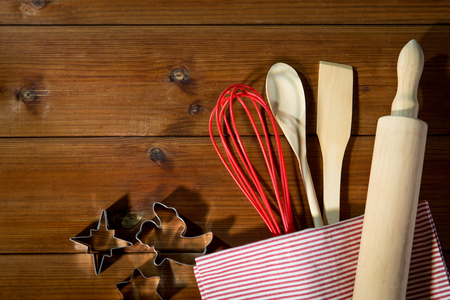 wooden table top view: baking, cooking, christmas and home kitchen concept - close up of kitchenware set for baking gingerbread on wooden board from top Stock Photo