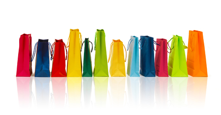 gift bags: sale, consumerism, advertisement and retail concept - many colorful shopping bags