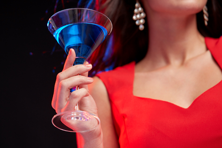 liquor girl: people, holidays, party, alcohol and leisure concept - close up of woman with cocktail at nightclub Stock Photo
