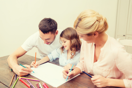 assignment: family, children and happy people concept - happy family drawing at home