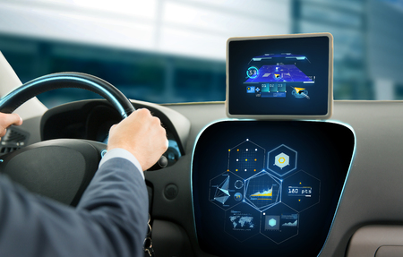 pc: transport, destination, modern technology and people concept - close up of man driving car with navigation system on tablet pc computer and charts