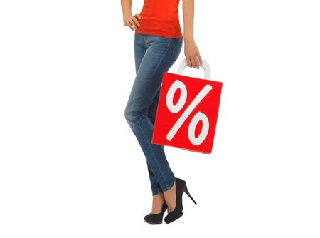 percentage sign: people, sale and discount concept - close up of woman with percentage sign on red shopping bag Stock Photo