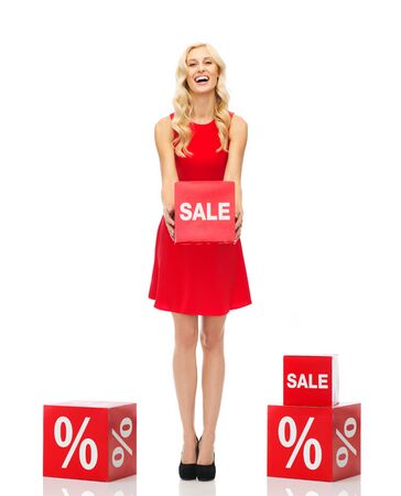 isolated sign: people, shopping, discount and holidays concept - smiling woman in red dress holding cardboard box with sale sign