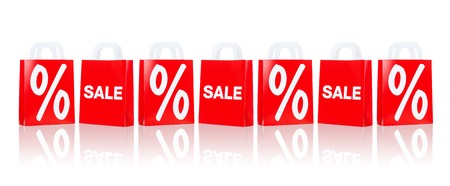 percentage sign: sale, consumerism, discount, advertisement and retail concept - many red shopping bags with percentage sign Stock Photo
