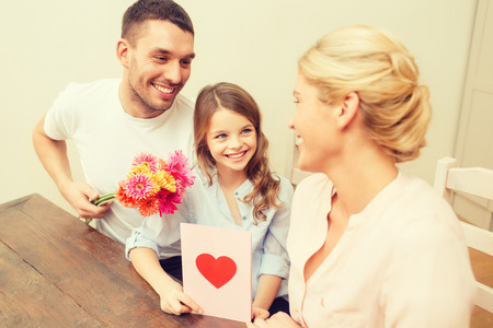 hapiness: holidays, family, hapiness and people concept - happy family celebrating mothers day Stock Photo
