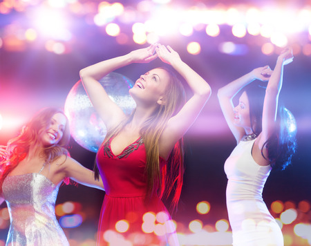 hen party: party, celebration, holidays, nightlife and people concept - happy women dancing at night club