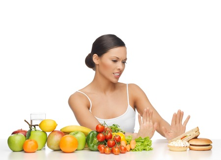 rejecting: picture of woman with fruits rejecting hamburger