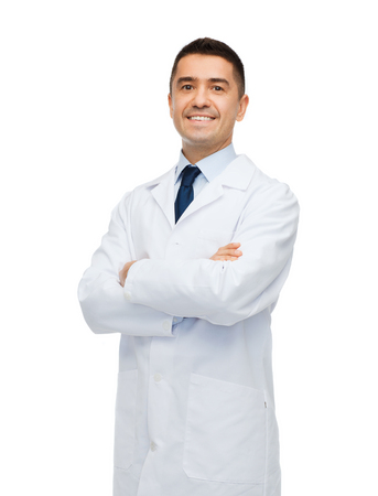 white coat: healthcare, profession, people and medicine concept - smiling male doctor in white coat