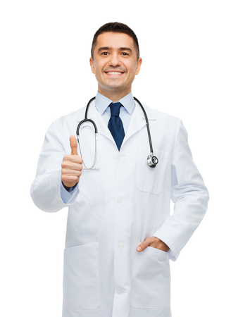 healthcare, profession, people and medicine concept - smiling male doctor in white coat showing thumbs up