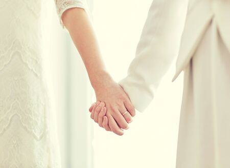 lesbian: people, homosexuality, same-sex marriage and love concept - close up of happy married lesbian couple hugging