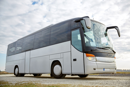 travel, tourism, road trip and passenger transport - tour bus parked outdoors Stockfoto