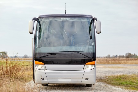 front view: travel, tourism, road trip and passenger transport - tour bus staying outdoors