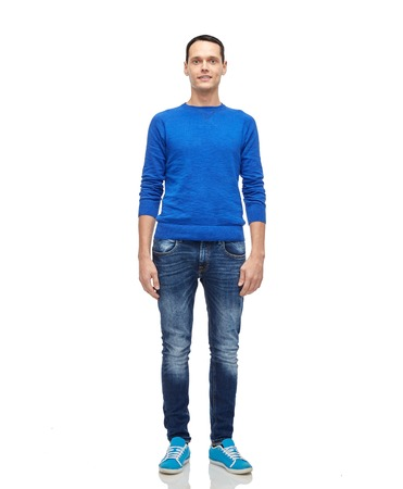 teenagers standing: male, gender, fashion and people concept - smiling young man in blue pullover and jeans