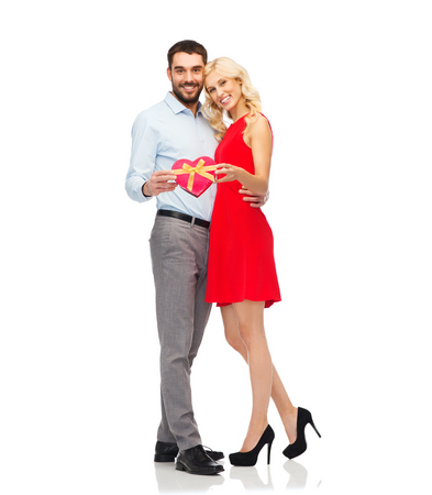 valentines: people, valentines day, love, couple and holidays concept - happy young man and woman with red heart shaped gift box Stock Photo