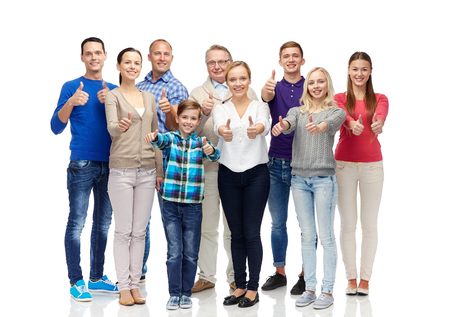 gesture, family, generation and people concept - group of smiling men, women and boy showing thumbs up
