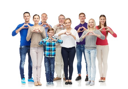 gesture, family, generation and people concept - group of smiling men, women and boy showing heart shape hand sign