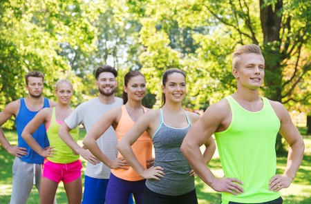 sportsmen: fitness, sport, friendship and healthy lifestyle concept - group of happy teenage friends or sportsmen outdoors