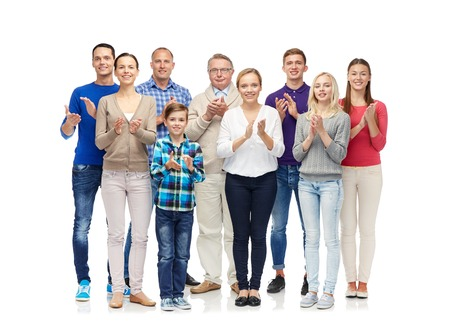 people clapping: family, gender, generation and people concept - group of smiling men, women and boy applauding Stock Photo