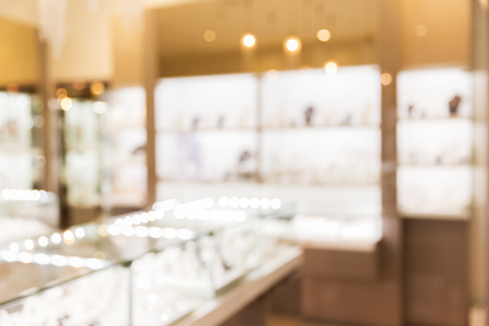 jewelry store: sale, consumerism, shopping and background concept - jewelry store blurred bokeh Stock Photo