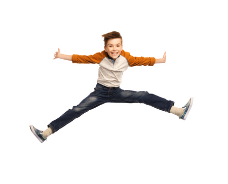 legs spread: happiness, childhood, freedom, movement and people concept - happy smiling boy jumping in air Stock Photo