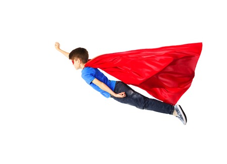 superhero: happiness, freedom, childhood, movement and people concept - boy in red superhero cape and mask flying in air