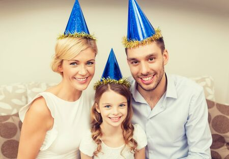 children birthday: celebration, family, holidays and birthday concept - happy family at home