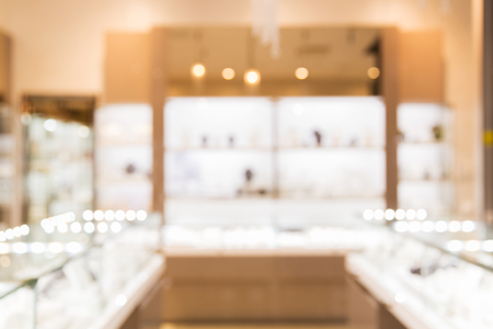 sale, consumerism, shopping and background concept - jewelry store blurred bokeh Banco de Imagens