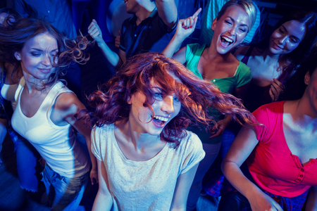 bachelorette: party, holidays, celebration, nightlife and people concept - smiling friends dancing in club