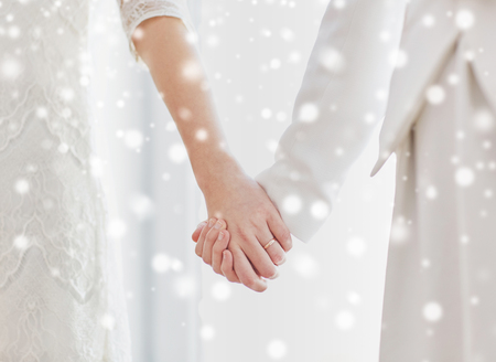 nude lesbian: people, homosexuality, same-sex marriage and love concept - close up of happy married lesbian couple hugging over snow effect