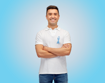 prostate cancer: medicine, health care, gesture and people concept - middle aged latin man in t-shirt with blue prostate cancer awareness ribbon pointing finger on himself