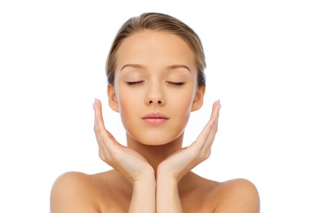 beauty, people, skincare and health concept - young woman face and hands Archivio Fotografico