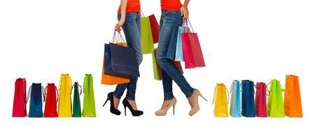 consumerism: people, sale and consumerism concept - close up of women with shopping bags