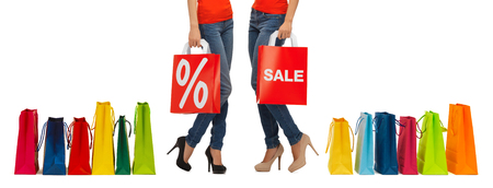 percentage sign: people, sale and discount concept - close up of women with percentage sign on red shopping bag