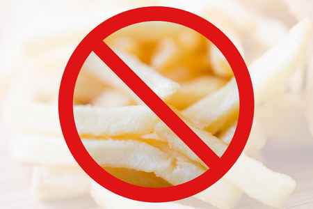 low carb diet: fast food, low carb diet, fattening and unhealthy eating concept - close up of french fries behind no symbol or circle-backslash prohibition sign