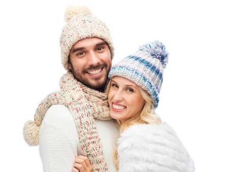 sweater girl: winter, fashion, couple, christmas and people concept - smiling man and woman in hats and scarf hugging