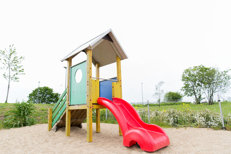 entertainment equipment: childhood, equipment and object concept - slide on playground outdoors Stock Photo