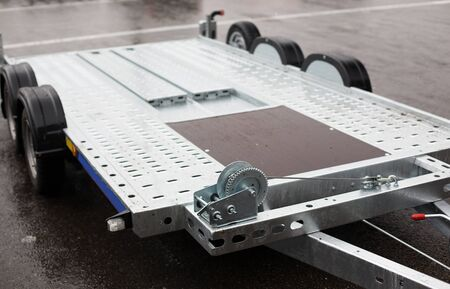 transportation and equipment concept - close up of trailer outdoors