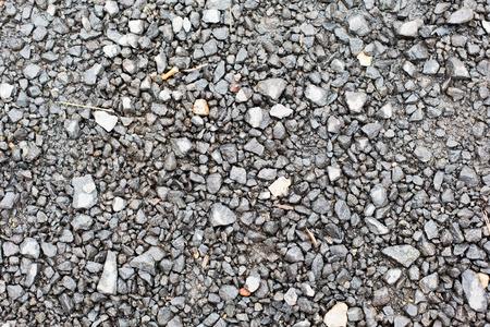 macadam: background and texture concept - close up of gray macadam stones on ground