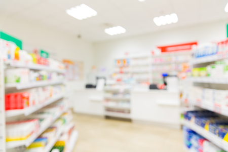 pharmacy: medicine, pharmacy, health care and pharmacology concept - pharmacy or drugstore room blurred background