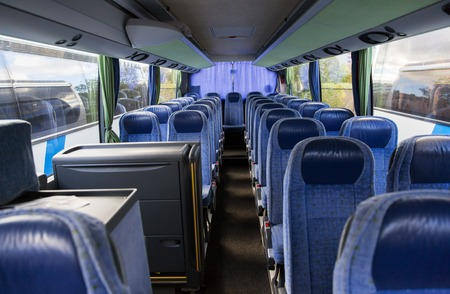 transport, tourism, road trip and equipment concept - travel bus interior. Stock Photo