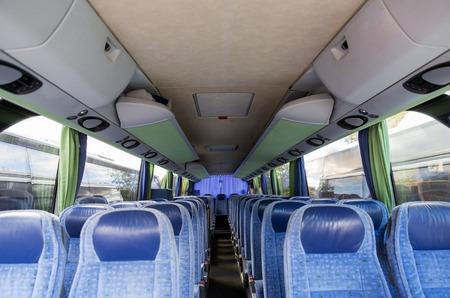 transport, tourism, road trip and equipment concept - travel bus interior