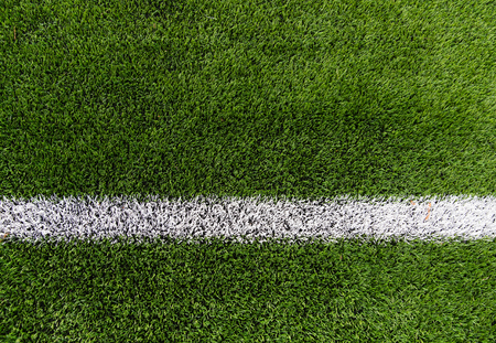 sport and game concept - close up of football field with line and grass Stock Photo