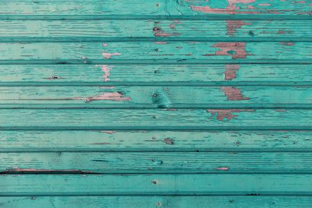 turquesa: antecedentes y textura concepto - antigua valla de madera pintada en fondo azul