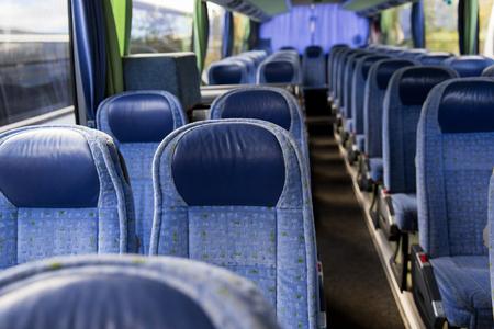 bus tour: transport, tourism, road trip and equipment concept - travel bus interior Stock Photo