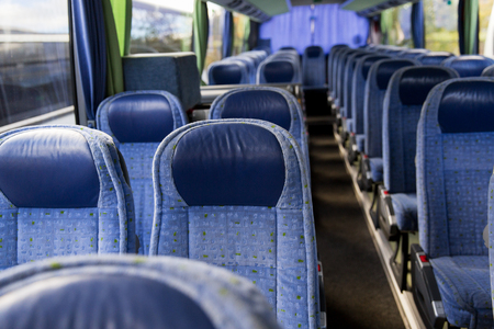 transport, tourism, road trip and equipment concept - travel bus interior Stock Photo