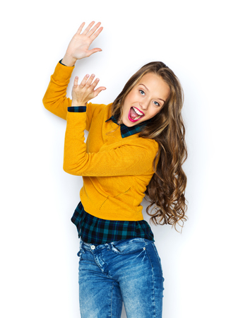 jeans: people, style and fashion concept - happy young woman or teen girl in casual clothes having fun and applauding